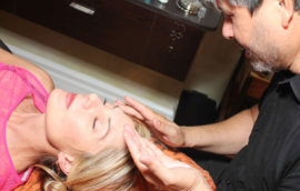 James Overstreet prepares a client for a sugar wax treatment to her brows and upper lip.